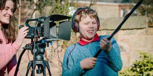 Kids making films: Boy on sound