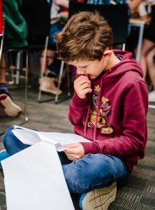 Boy reading a script